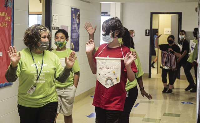 All-star students march with staff down Mahaffey Middle School hallway May 18 before All-star Field Day.