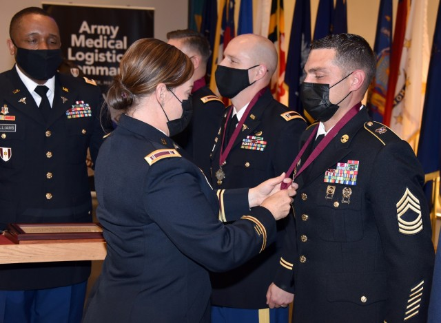 Awarding O2M3 medallion