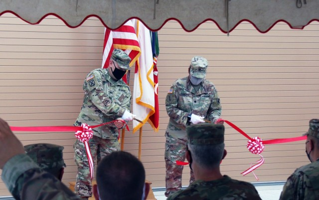 Col. Thomas J. Verell, Jr., Japan Engineer District commander, and Lt. Col. Rosanna Clemente, 1st Battalion, 1st ADA commander, cut the ribbon, officially opening the most advanced Patriot Missile Storage Facility in the world.