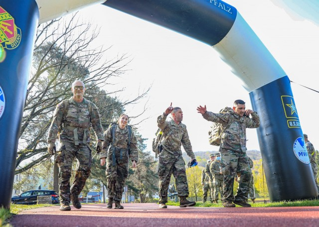 """""""Diamond Nation"""" a four-person team comprised of company first sergeants from Troop Command, Landstuhl Regional Medical Center, cross the finish line at the inaugural LRMC Legacy Challenge, May 7. The event tested the teams in physically demanding challenges, including various exercises, a six-mile ruck march, and numerous obstacles challenging competitors in warrior and life-saving tasks. (U.S. Army photo by Marcy Sanchez)"""