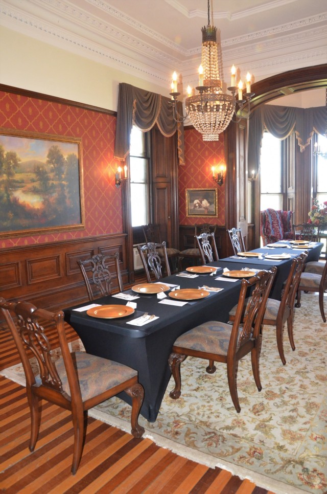 The dining room originally featured a massive walnut dining table able to seat up to 15 guests and was built by Arsenal craftsmen in 1878. Today's furnishings are smaller and more modern, yet still elegant, as shown at a recent luncheon setting.