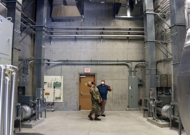Col. Thomas J. Verell, Jr., is given a tour of the newly opened Patriot Missile Storage Facility in Okinawa, Japan. The facility is designed to control both temperature and humidity, keeping missiles ready to go at a moment's notice.