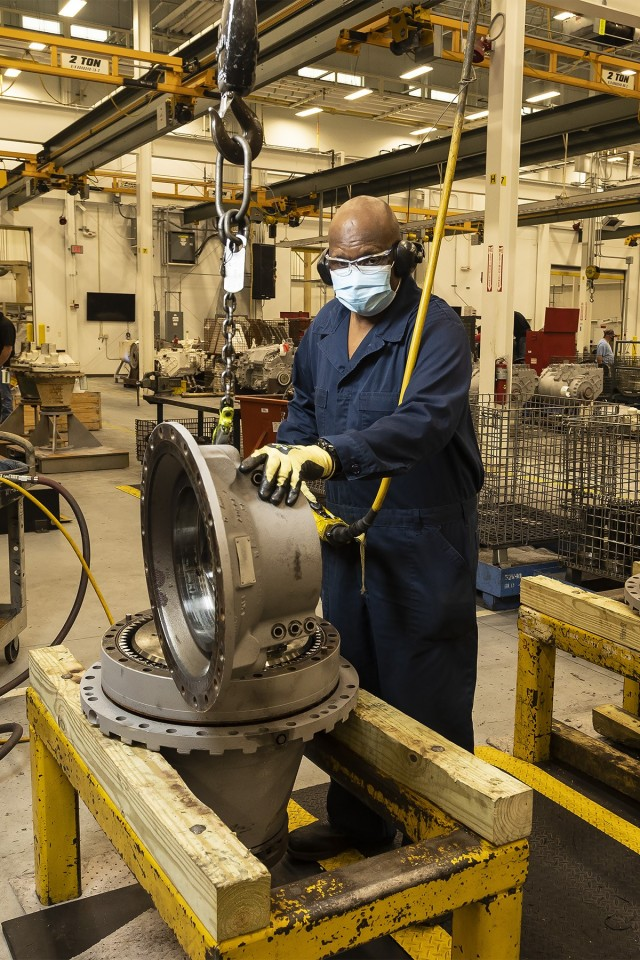 Nathaniel Williams, a heavy mobile equipment mechanic, disassembles a final drive for the M1 Abrams in the Final Drive Branch at Anniston Army Depot.