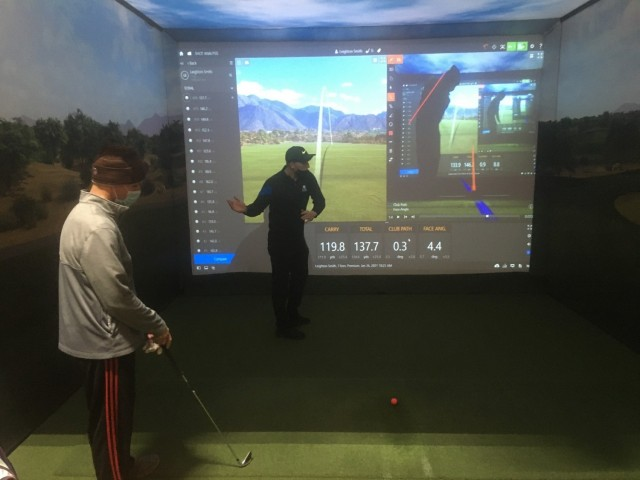 Maj. Scott Robison (left), a Soldier assigned to the Fort Carson Soldier Recovery Unit, Colo., participated in an indoor golf program taught by Professional Golfers' Association Coach Leighton Smith (right). The six-week program is offered by the SRU's adaptive reconditioning program during the winter months at an indoor golf range in Colorado Springs. (Photo courtesy of Marc Cattapan)