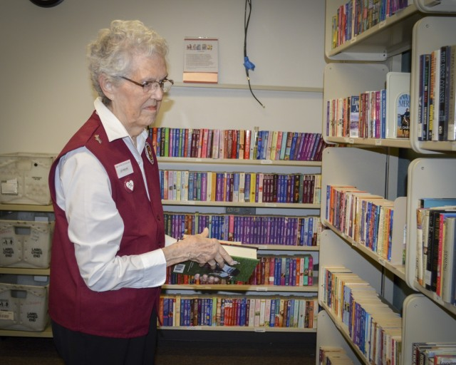 Joy Moore, volunteer, sorts books in the Patient Library at Brooke Army Medical Center, Fort Sam Houston, Texas, May 27, 2021. Moore is retiring after 36 years of volunteer service. (U.S. Army photo by Lori Newman)