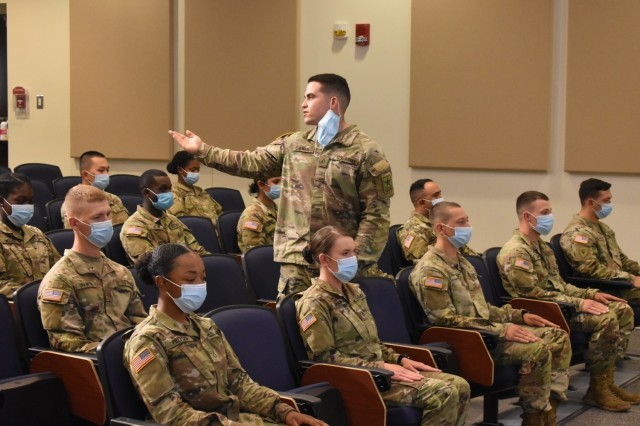 Pfc. Mason Calhoun, introduces his Family members during the Advanced Individual Training graduation ceremony for 56M, religious affairs specialist, of class 21-007 on May 13. (Photo by Mel Slater)