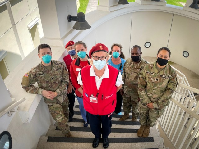 Volunteers from the Vicenza chapter of the Italian Relief Corps of the Order of Malta, American Red Cross, and staff members of the USAHC-Vicenza gather for a group photo during a small break from vaccinating the host nation professionals, May 25, 2021.
