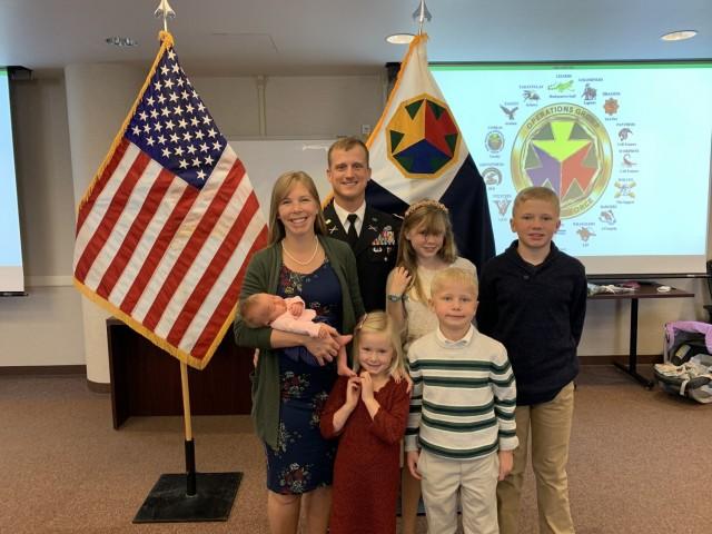 Lt. Col. Jim Nemec poses with wife, Lindsay Nemec and five children.