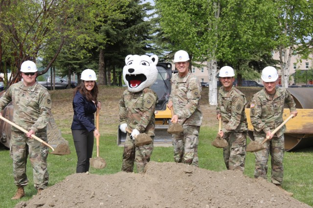 GROUNDBREAKING CEREMONY - Medical Department Activity – Alaska hosted a groundbreaking ceremony with partners from U.S. Army Alaska and U.S. Army Garrison May 26, 2021 at Kamish Soldier Centered Medical home.  Kamish SCMH provides ambulatory care to approximately 6,500 active duty Soldiers assigned to Ft. Wainwright. The building expansion, projected for completion in the fall of 2024 will add 6,200 square feet to the clinic. (Left to Right: Command Sgt. Maj. Robert M. Preusser, USAG Alaska Command Sgt. Maj.; Catherine Miller, USAG Alaska Deputy to the Garrison Commander; Sgt. Binky, Maj. Gen. Peter Andrysiak, USARAK Commanding General; Col. Eli Lozano, MEDDAC-AK Commander; Command Sgt. Maj. Matthew R. Gritta.)