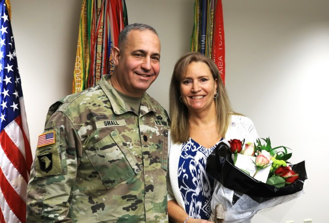 Mrs. Kristen Small stands with her husband Lt. Col. Michael Small after being named as U.S. Army Central Volunteer of the Year during a ceremony at Fort Knox, Kentucky May 26, 2021. Small was honored for her volunteer service with 1st Theater Sustainment Command. (U.S. Army photo by Spc. Owen Thez)