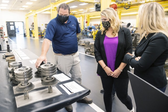 Adam Harvey, division chief of the Turbine Drive Train Division, shows Christine Mitchell, a public affairs specialist from the Army Materiel Command, parts of a turbine engine during a May 19 visit.