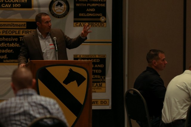 Col. Jonathan Bender, 1st Cavalry Division senior operations and planning officer, details the First Team's vision and concepts for readiness, modernization and People First initiatives during the division's CAV Leadership Forum at the Killeen Civic and Conference Center in Killeen, Texas, May 20, 2021. Division brigade and battalion command teams and senior leaders attended to synchronize efforts to successfully transform the division culture and enhance results in upcoming changes to unit capabilities and structure. Having tested a few programs for the Army, the Division is ready to implement through predictability, stabilization and synchronization that Bender said was the CAV leading the way for the Army's vision of future warfighter capabilities. (U.S. Army photo by Sgt. 1st Class Ashleigh E. Martinez)