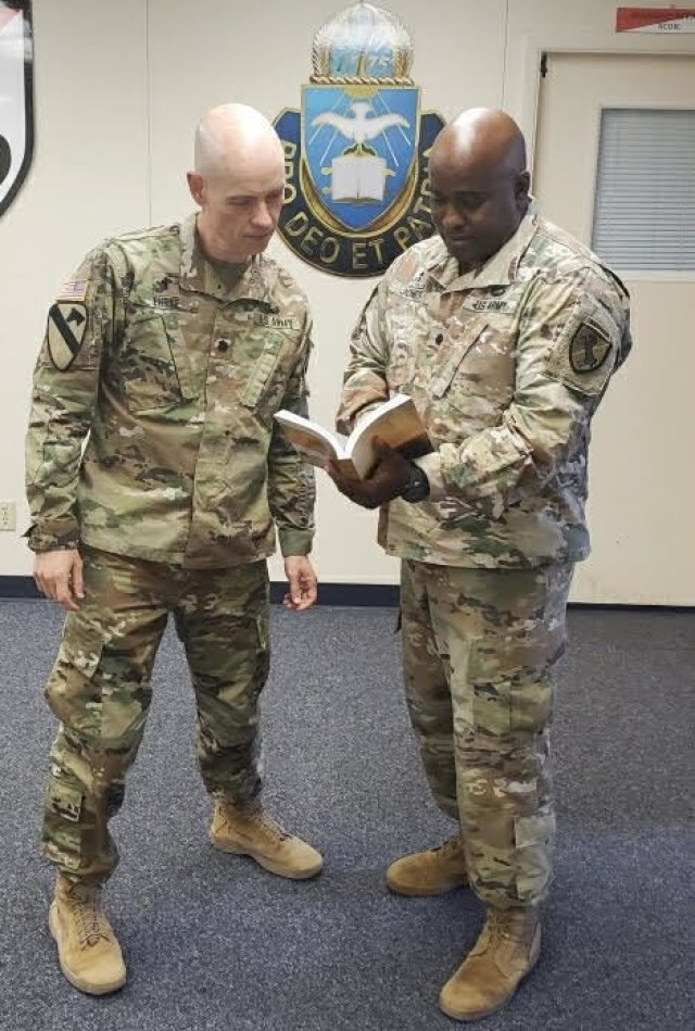 Chaplain (Lt. Col.) Donald Ehrke and Chaplain (Lt. Col.) Terrell Jones study material on counseling. Photo Credit: Casey Slusser, Fort Irwin Public Affairs