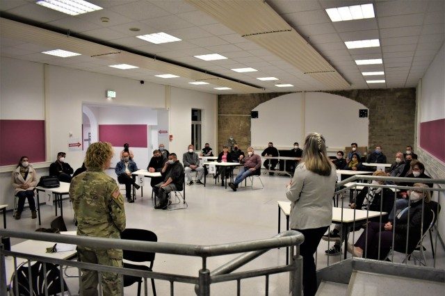 Col. Karen Hobart, garrison commander, and Command Sgt. Maj. Eric Bohannon address employees of the USAG Ansbach Directorate of Public Works to discuss potential improvements of internal processes and services, to ultimately improve customer service as a whole, at Bismarck Kaserne, May 21, 2021.