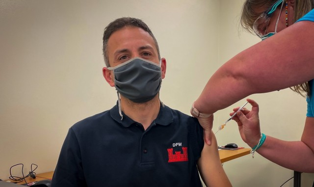 """Nicola Zancan, an employee for DPW, Road Zone and Group section,  receives his first dose of the Pfizer vaccine. """"I wish to go back to normal soon, without a mask. I am happy to be here to receive a vaccine"""" USAHC-Vicenza provided an opportunity for host nation professionals, including contractors, to receive their anti-COVID vaccines May 25, 2021."""