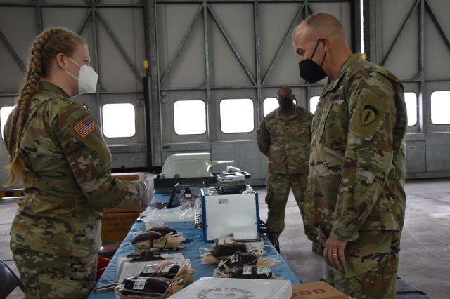WIESBADEN, Germany – Pfc. Skyler Nisbet explains to Brig. Gen. Jed Schaertl how the blood products are packaged and shipped to Landstuhl Regional Medical Center after a blood drive.