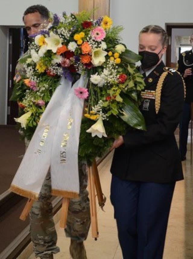 Col. Mario Washington, U.S. Army Garrison Wiesbaden Commander and Cadet Lt. Col. Ella Griffin presents a wreath at the Wiesbaden School Complex Memorial Day Ceremony May 26 on Hainerberg Kaserne.