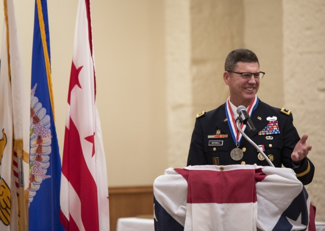 Maj. Gen. Daniel Mitchell shares a laugh as he speaks during his retirement ceremony May 27. Mitchell also relinquished command of the U.S. Army Sustainment Command during the ceremony. (Photo by Linda Lambiotte, ASC Public Affairs)