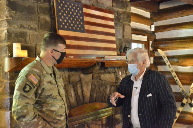 Dawson W. Durrett Jr. shares memories of growing up on present-day Fort Campbell with Brig. Gen. Clair Gill, deputy commanding general-support, 101st Airborne Division (Air Assault), May 20 at his historic home in Cole Park. Durrett's father started building the structure in early 1932, making it the installation's oldest residence, and Durrett lived there as a child from 1933 until the U.S. government purchased the property in 1941.