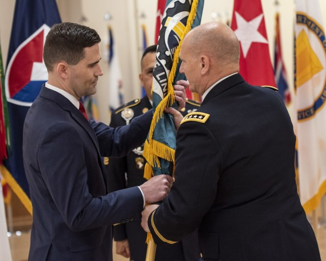 Matthew Sannito, ASC deputy to the commanding general, receives the ASC flag from Gen. Ed Daly, commanding general of the U.S. Army Materiel Command, during a relinquishment of command and retirement ceremony May 27. Sannito will serve as executive director of ASC pending the arrival of Maj. Gen. Christopher Mohan as commanding general. (Photo by Linda Lambiotte, ASC Public Affairs)