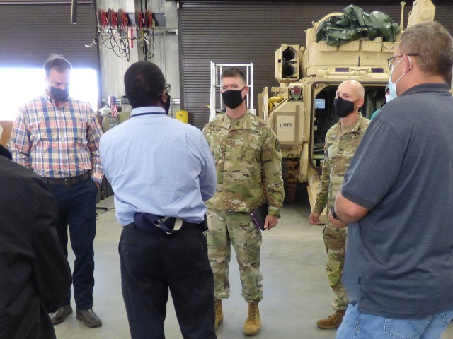 Maj. Gen. Patrick Donahoe (center background), Commanding General U.S. Army Maneuver Center of Excellence, and Col. Bryan Fowler (right background), Deputy Chief of Staff-Sustainment for MCoE, receives a briefing from the U.S. Army Tank-automotive and Armaments Command's Fleet Maintenance Expansion Light Track team on the M2A3 Bradley during his visit to the FMX on Fort Benning, Georgia May 6.