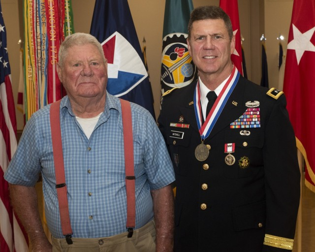 Maj. Gen. Daniel Mitchell stands with his father, Dr. Marvin Mitchell – a Korean War veteran and retired veterinarian – during a relinquishment of command and retirement ceremony May 27. (Photo by Linda Lambiotte, ASC Public Affairs)
