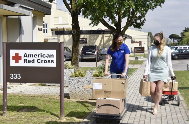 VICENZA, Italy - Michelle Sterkowicz, U.S. Army Garrison Italy Art Center program manager, (left) and Aurora Venden, American Red Cross Interim Regional program manager deliver 'Resiliency through Art' individual kits to several locations on Caserma Ederle May 5, 2021. The Art Center worked in partnership with volunteers and organizations to deliver approximately 700 kits to help discover the benefits of art during COVID-19.