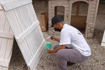 USAG Italy volunteers help beautify Italian school