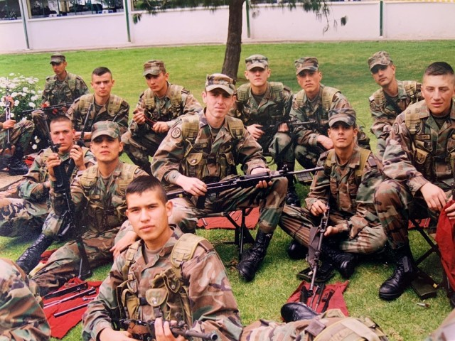 Cadet Mauricio Garcia, without hat in foreground, and fellow classmates, pose for a photo during a field exercise at the military officer school in Bogota, Colombia. Garcia, now a Chief Warrant Officer 3 with the U.S. Army, is deployed to Tolemaida Army Base in Colombia as part of a technical advising team from U.S. Army Security Assistance Command's Fort Bragg-based training unit, the Security Assistance Training Management Organization. (Courtesy photo)
