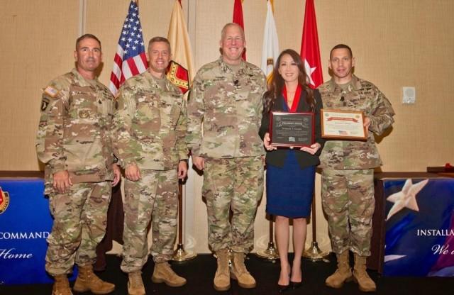 Kimberly Straube receives the IMCOM Stalwart Award at a ceremony in November 2019.