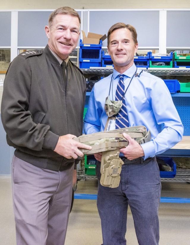 John Kirk briefs Gen. James C. McConville, during a visit to DEVCOM Soldier Center