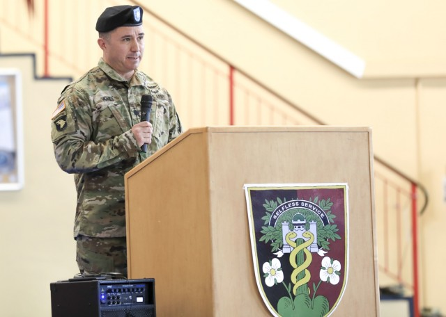 U.S. Army Lt. Col. Mark Jones, commander, U.S. Army Health Clinic Baumholder (BAHC), provides remarks during a change of command ceremony where U.S. Army Lt. Col. Elizabeth Gum relinquished command to Jones at Baumholder, May 26. U.S. Army Health Clinic Baumholder provides ambulatory care for Soldiers, their families, and others, and offers acute and chronic care of pediatric and adult patients, physical examinations, health-related career screening and immunizations, non-operative gynecological diagnosis and treatment, minor surgical procedures and surgical follow-up and newborn care. Baumholder Army Health Clinic also provides specialty care services to include behavioral medicine, pharmacy, optometry, radiology and physical therapy.