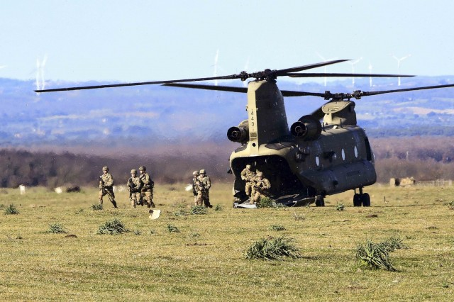 Soldiers conduct a simulated air assault from an Army CH-47 Chinook during training at Monte Romano Training Area, Italy, Jan. 27, 2021.