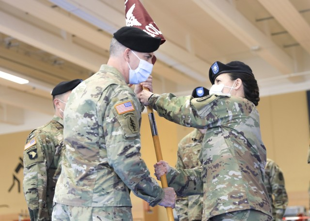 U.S. Army Lt. Col. Elizabeth Gum, outgoing commander, U.S. Army Health Clinic Baumholder, passes the unit colors to U.S. Army Col. Andrew Landers, commander, Landstuhl Regional Medical Center, during a change of command ceremony where Gum relinquished command of U.S. Army Health Clinic Baumholder (BAHC) to Jones at Baumholder, May 26. U.S. Army Health Clinic Baumholder provides ambulatory care for Soldiers, their families, and others, and offers acute and chronic care of pediatric and adult patients, physical examinations, health-related career screening and immunizations, non-operative gynecological diagnosis and treatment, minor surgical procedures and surgical follow-up and newborn care. Baumholder Army Health Clinic also provides specialty care services to include behavioral medicine, pharmacy, optometry, radiology and physical therapy.