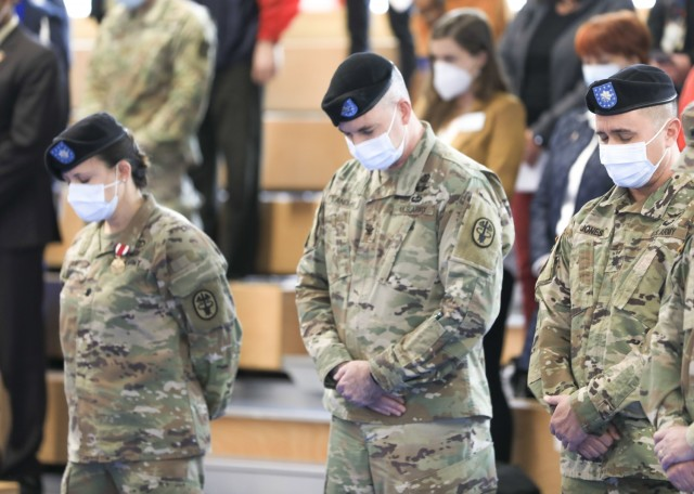 (From left) U.S. Army Lt. Col. Elizabeth Gum, outgoing commander, U.S. Army Health Clinic Baumholder (BAHC), U.S. Army Col. Andrew Landers, commander, Landstuhl Regional Medical Center, and U.S. Army Lt. Col. Mark Jones, incoming commander, BAHC, bow heads during invocation at BAHC's change of command ceremony where Gum relinquished command to Jones at Baumholder, May 26. U.S. Army Health Clinic Baumholder provides ambulatory care for Soldiers, their families, and others, and offers acute and chronic care of pediatric and adult patients, physical examinations, health-related career screening and immunizations, non-operative gynecological diagnosis and treatment, minor surgical procedures and surgical follow-up and newborn care. Baumholder Army Health Clinic also provides specialty care services to include behavioral medicine, pharmacy, optometry, radiology and physical therapy.
