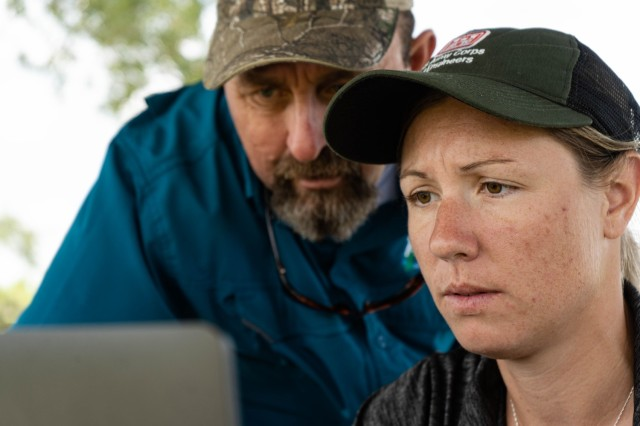 Jessica Fair, U.S. Army Corps of Engineers, biologist and Keith Mangus, Applied Aquatics, project manager view on a laptop how the Spray Tracker Platform developed by FWC's Andrew Dew detects and collects the spray path of the licensed applicators out in the field in real time.