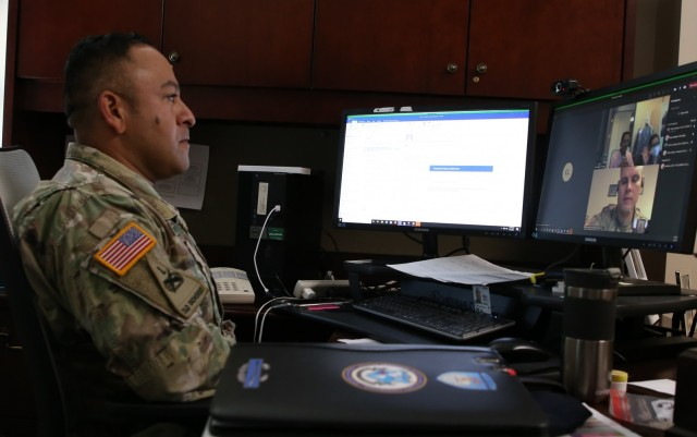 Master Army Instructor (MAI) candidate, MSG John F. Martinez listens to the administrative instructions from MAI SFC Jeffrey Parker (lower half of the computer screen).
