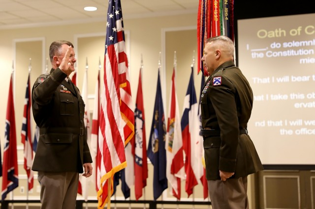 Gen. Paul E. Funk II, Training and Doctrine Command commanding general, administers the oath of office to Brig. Gen. Charles Lombardo Combined Arms Center-Training deputy commanding general during his promotion ceremony May 28, 2021 at the Frontier Conference Center, Fort Leavenworth, Kan. Photo by Tisha Swart-Entwistle, Combined Arms Center-Training.