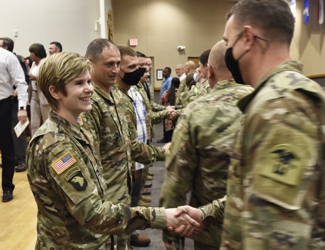 Capt. Jennifer Ward is congratulated June 2 at Lincoln Hall Auditorium after being named the U.S. Army Engineer School's 2020 Officer Instructor of the Year. Maneuver Support Center of Excellence leaders recognized the center's calendar year 2020 instructors of the year and 2021 civilians of the year during the ceremony.