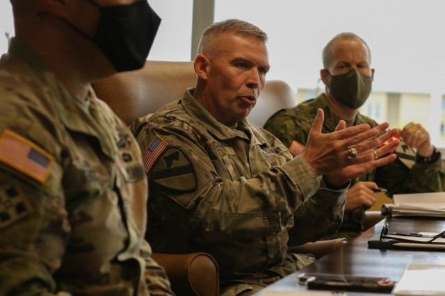Col. Kevin Capra, 1st Cavalry Division chief of staff, discusses collaboration concepts and efforts to better field and test future warfighter capabilities with representatives from the U.S. Army Combat Capabilities Development Command [DEVCOM] Army Research Laboratory and the U.S. Army Operational Test Command during a round table discussion at the division's Headquarters at Fort Hood, Texas, May 12, 2021. The visit opens the way to align and build relationships that collaborate and formalize beneficial partnerships in technology, modernization and innovation.