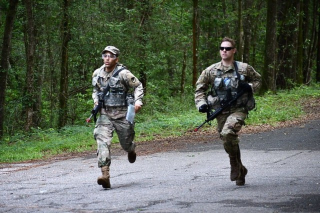 Spc. Jaycob Vellon-Colon from Letterkenny Army Depot (left) and Staff Sgt. Daron Ashcraft from the U.S. Army Aviation and Missile Command Aviation Center Logistics Command finish the land navigation strong May 11. The Soldiers took part in the 2021 U.S. Army Aviation Center of Excellence Best Warrior Competition at Fort Rucker, Ala., May 10-14. Ashcraft earned the title of AMCOM Noncommissioned Officer of the Year.