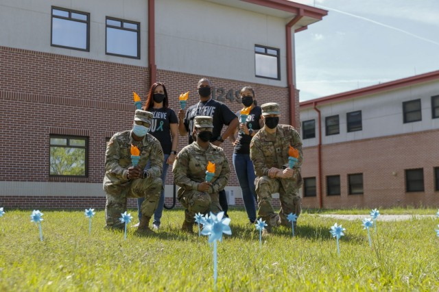 The 3rd Combat Aviation Brigade Sexual Assault Response Coordinators, Victim Advocate, and representatives of the Marne Air Advisory Board stand behind teal pinwheels, Apr. 27 at Hunter Army Airfield, Georgia. Teal is the official color of sexual assault awareness and prevention month, and the pinwheels are a symbol of sexual violence prevention.