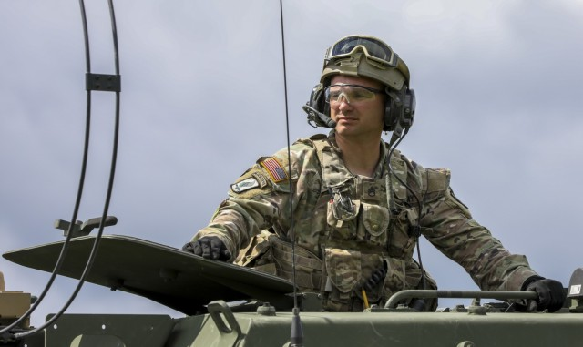 A U.S. Army Soldier assigned to Alpha Battery, 1st Battalion, 77th Field Artillery Regiment, 41st Field Artillery Brigade, monitors vehicle movement while preparing for a  rapid infiltration high mobility artillery rocket system live-fire exercise during Saber Guardian, at Novo Selo, Bulgaria, June 1, 2021. Saber Guardian 21 is a sub-exercise of Defender 21, a 7th Army Training Command-led, U.S. Army Europe and Africa-directed exercise designed to increase readiness, lethality and interoperability by exercising allied and partner nations' ability to integrate joint fires in a multinational environment at both the operation and tactical levels. (U.S. Army photo by Spc. Zack Stahlberg)