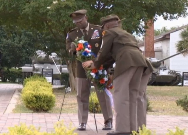 Post Command Sgt. Maj. Philson Tavernier and Fort Jackson Commander Brig. Gen. Milford H. 'Beags' Beagle Jr. place a wreath  at the post flag pole in honor of service members who died serving the nation during the installation's Memorial Day ceremony at Centennial Park May 31. (Screenshot)