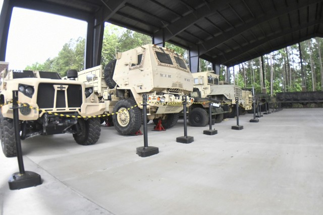 A view from one of the newest additions to the Army inventory – the Joint Light Tactical Vehicle  (far left) -- at the new Transportation pavilion located at the corner of 22nd Street and Railroad Avenue