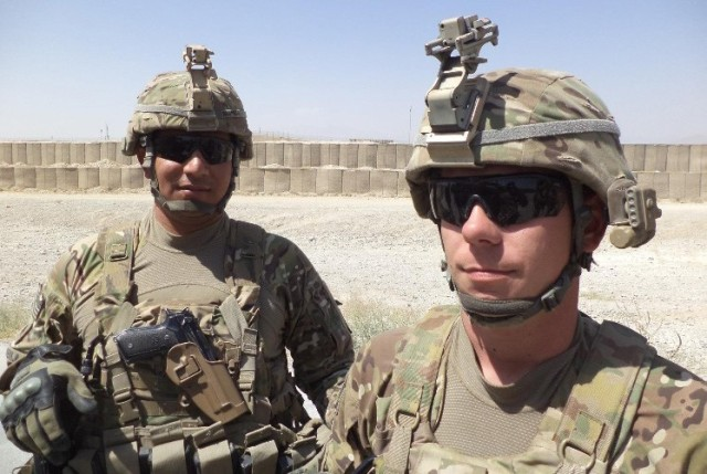 Staff Sgt. Gustavo Brambila captures a selfie with a battle buddy while deployed to Forward Operating Base Shank, Afghanistan, in 2012. During that deployment, Brambila suffered a traumatic brain injury during an artillery explosion, and it nearly ended his Army career.