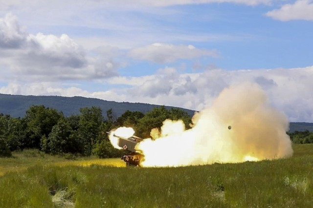 U.S. Army Soldiers assigned to Alpha Battery, 1st Battalion, 77th Field Artillery Regiment, 41st Field Artillery Brigade, conduct a  rapid infiltration high mobility artillery rocket system live-fire exercise during Saber Guardian, at Novo Selo, Bulgaria, June 1, 2021. Saber Guardian 21 is a sub-exercise of Defender 21, a 7th Army Training Command-led, U.S. Army Europe and Africa-directed exercise designed to increase readiness, lethality and interoperability by exercising allied and partner nations' ability to integrate joint fires in a multinational environment at both the operation and tactical levels. (U.S. Army photo by Spc. Zack Stahlberg)