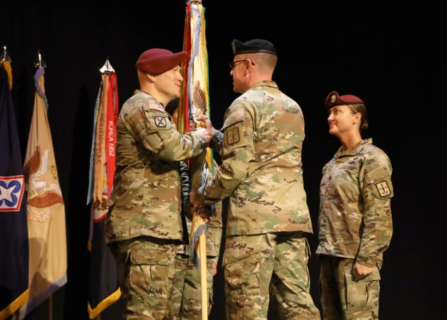 Lt. Col. Daniel T. Trost receives the unit colors from Col. Jason P. Affolder during a June 4 change of command ceremony at Fort lee, Va. Trost, who will take command of the 262nd Quartermaster Battalion, replaced Lt. Col. Heather M. Reilly who will be heading off to the 82nd Airborne Division G/4 for a year,  and then transition to the Senior Service College.
