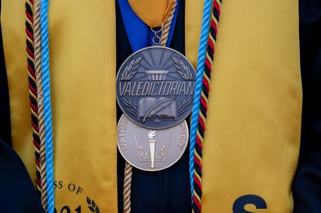 A Stuttgart High School valedictorian medal is seen during an outdoor, drive-in graduation ceremony at Panzer Barracks, Germany, June 2, 2021.