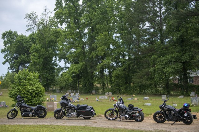 Motorcycles line the path at the Gates of Heaven Cemetary during the 165th Infantry Brigade Memoria Day Ride event May 28.